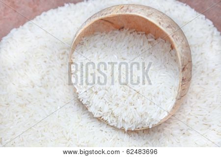 Uncooked Rice In Coconut Shell Bowl