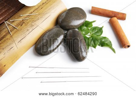 Composition with needles for acupuncture, isolated on white