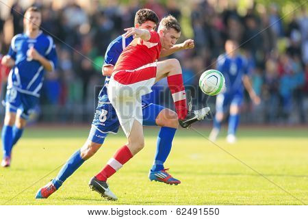TRAISKIRCHEN, AUSTRIA - JUNE 5 Lukas Jaeger (#3 Austria) and Mirko Maric (#8 Bosnia and Herzegovina) fight for the ball during the U19 game on June 5, 2013 in Traiskirchen, Austria.