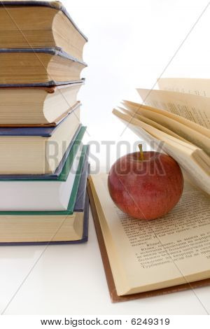 Red Apple And Pile Of Books.