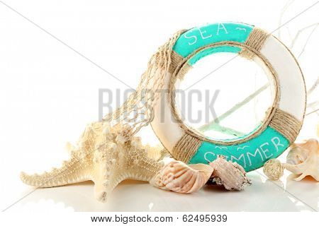 Lifebuoy and sea shells, isolated on white