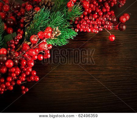Christmas wreath from red berries, a fur-tree and cones