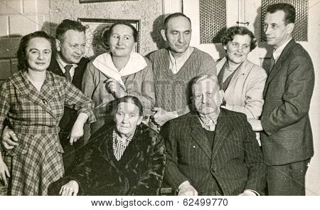 LODZ, POLAND, CIRCA 1950's: Vintage photo of family posing together
