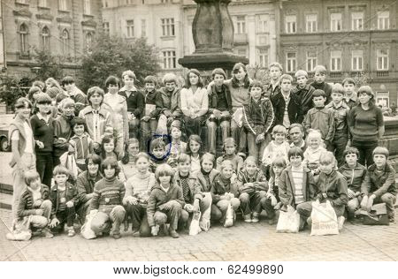 GOCZALKOWICE, POLAND, AUGUST 8, 1981: Vintage photo of group of classmates and teachers posing together during a school excursion