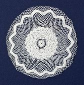 foto of doilies  - Handmade doily on blue background - JPG