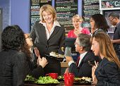 stock photo of embarrassing  - Embarrassed cafe manager with group of unsatisfied customers - JPG