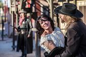 stock photo of bandit  - Woman has been captured by old west bandit - JPG