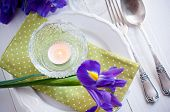 image of purple iris  - Festive table setting with purple iris flowers vintage cutlery and candles - JPG