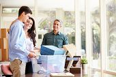 stock photo of leaving  - Parents Helping Teenage Son Pack For College - JPG