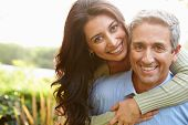 stock photo of hispanic  - Portrait Of Loving Hispanic Couple In Countryside - JPG