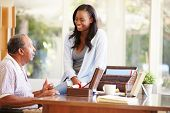 picture of keepsake  - Senior Father Discussing Document With Adult Daughter - JPG