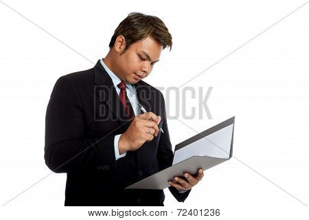 Asian Businessman Sign Signature In A Report