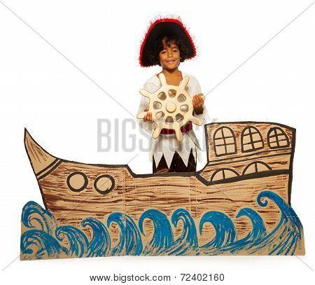 Boy playing pirate no cardboard ship steering