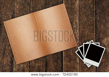 Old Book On Wooden Background With Photo