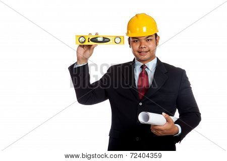Asian Engineer Man  Hold Blue Print And Level Look At Camera