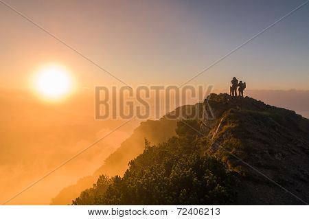 Tourists Watching The Sunrise At The Top Of The Mountain