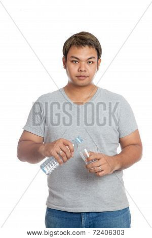 Asian Strong Man Pour Water Into A Glass Look At The Camera