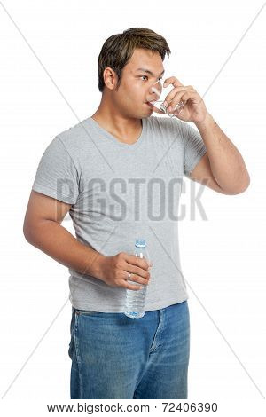 Asian Strong Man Is Drinking  Water From A Glass