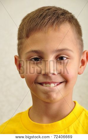 Portrait Of Happily Smiling Boy