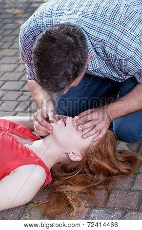 Man Doing Artificial Respiration