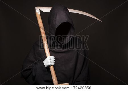 Death reaper over black background. Halloween.