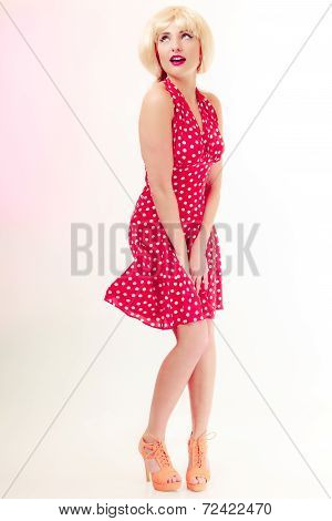 Full Lengthbeautiful Pinup Girl In Blond Wig Retro Red Dress. Vintage.