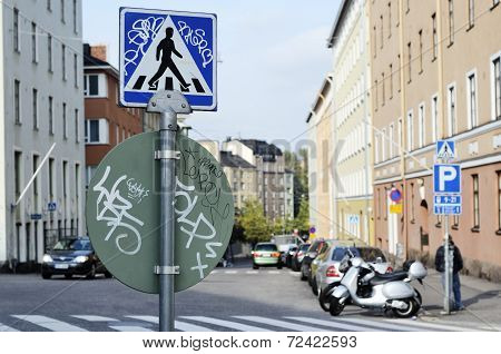 Road Signs With Graffiti At A Crossroads