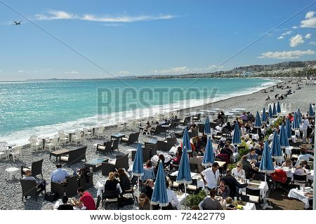 Vacationers Sitting In Cafe On Beach, French Riviera, Nice