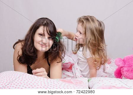Girl Combing Her Hair With Enthusiasm Mum