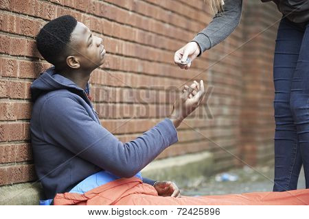 Teenage Boy Sleeping On The Street Being Given Money
