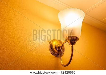 Vintage Wall Lamp On The Yellow Wall