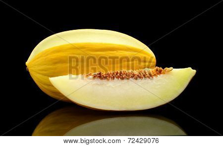 Studio Shot Of Sliced Canary Melon Isolated Black