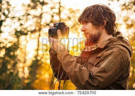 Young Man With Retro Photo Camera Outdoor Lifestyle Concept Sunlight Forest Nature On Background