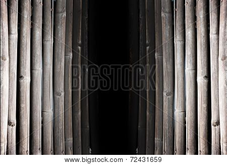Black Hold Between Old Bamboo Pannel