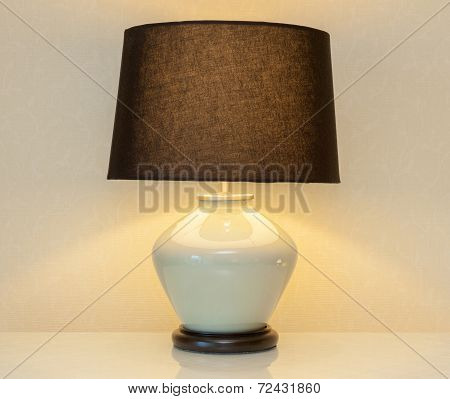 Shinning Lamp On Bedside Table