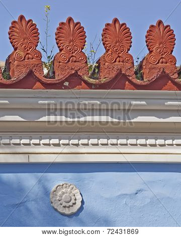 yellow flower on vintage roof antefix