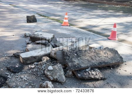Road repairing works. destroyed asphalt,