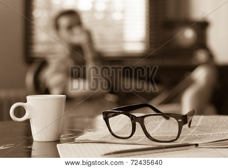 Cup Of Coffee Newspaper Man