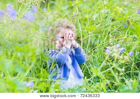 Cute Funny Baby Girl Playing Hide And Seek In The Garden