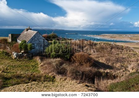 Scenic Irish Landscape With Old Irish Cottage By Sea