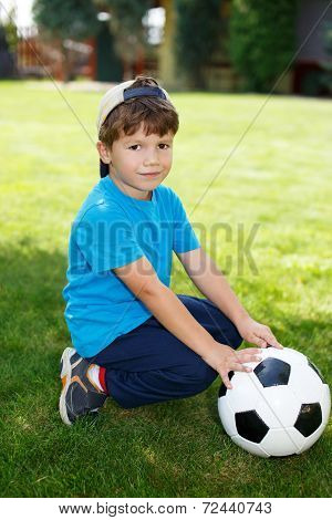 Little Boy In Cap With Soccer Ball