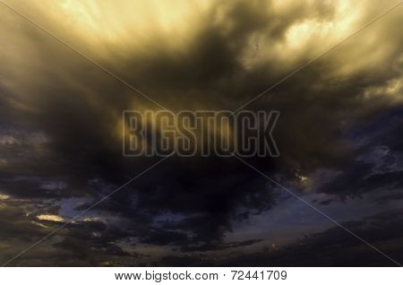 Storm Cloud Hanging Ominously Above The Ground