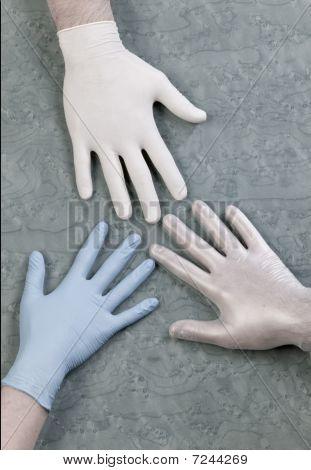 three medical or surgical gloves