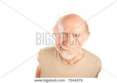 Senior Man With Cigarette Stub