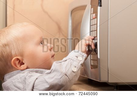 Boy Child Kid Playing With Timer Of Microwave Oven