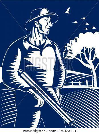hunter with shotgun rifle in farm