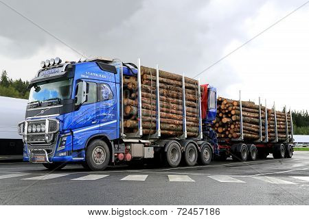 Blue Volvo FH16 700 Timber Truck With Log Trailer