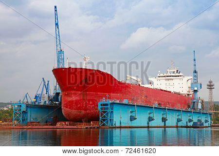 Big Red Tanker Under Repairing In Blue Floating Dock, Varna