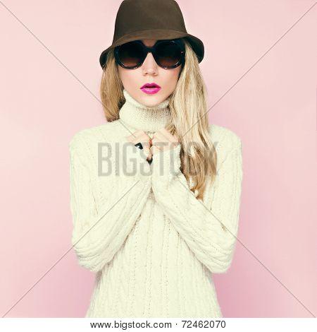 beautiful autumn girl in a warm sweater