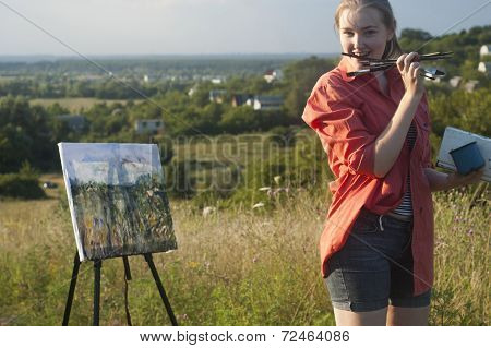 Painter With Brush In Her Mouse